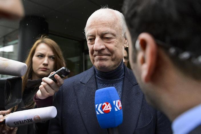 UN envoy for Syria Staffan de Mistura leaves after a meeting with the opposition leaders during peace talks in Geneva on January 31, 2016 (AFP Photo/Fabrice Coffrini)