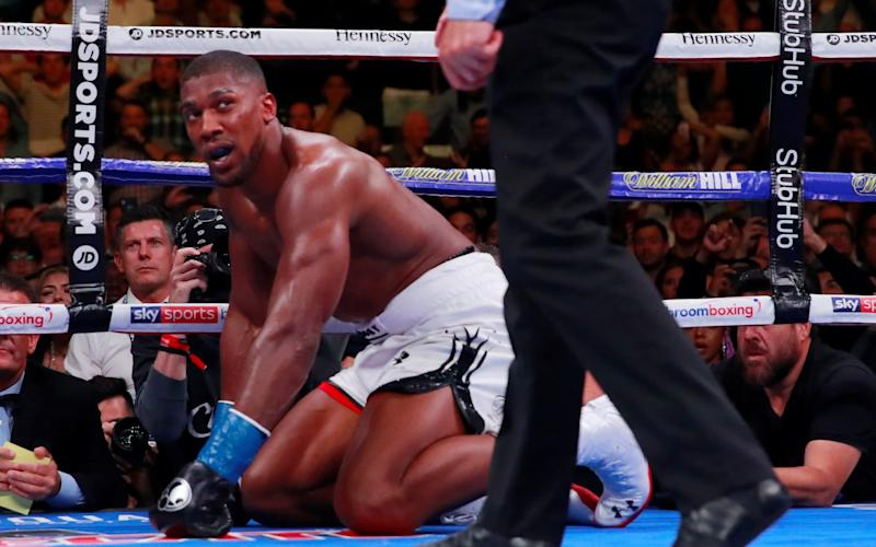Anthony Joshua struggles to pick himself up off the canvas - Action Images via Reuters