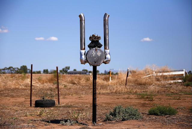 <p>An old car engine that has been converted into a mailbox is seen in the outskirts of Walgett township, northwest of Sydney, Australia. (Photo: David Gray/Reuters) </p>