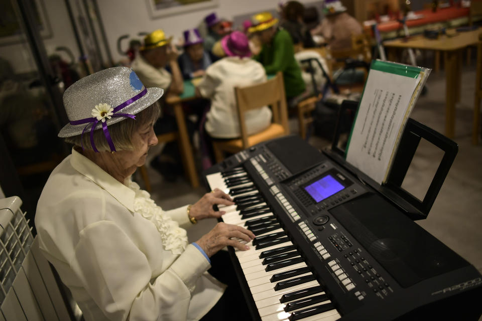 Conchita, 90 years old, a resident of the San Jeronimo nursing home, plays a keyboard during New Year's Eve celebrations in Estella, northern Spain, Thursday, Dec. 31, 2020. (AP Photo/Alvaro Barrientos)