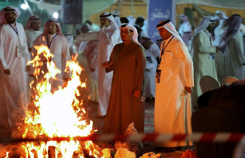 Kuwaitis attend an election campaign meeting for the upcoming parliamentary election, in Kuwait City