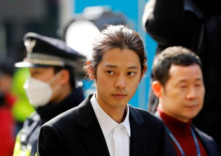 South Korean singer Jung Joon-young arrives for questioning on accusations of illicitly taping and sharing sex videos on social media, at the Seoul Metropolitan Police Agency in Seoul, South Korea, March 14, 2019.   REUTERS/Kim Hong-Ji
