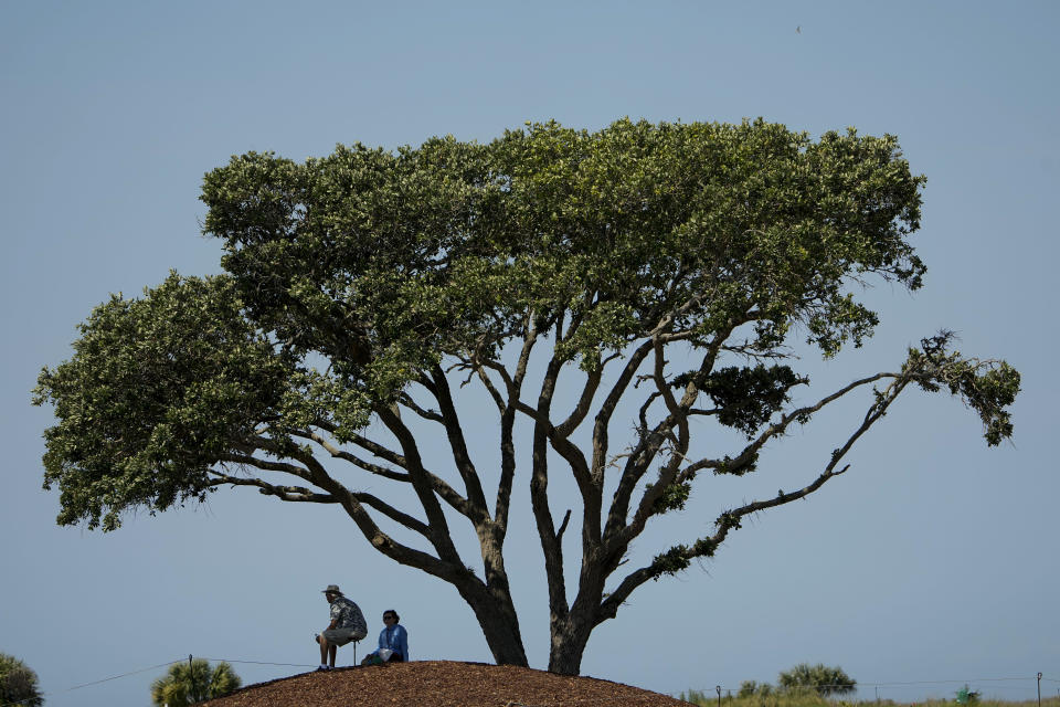 Fans watch on the seventh hole during a practice round at the PGA Championship golf tournament on the Ocean Course Tuesday, May 18, 2021, in Kiawah Island, S.C. (AP Photo/David J. Phillip)