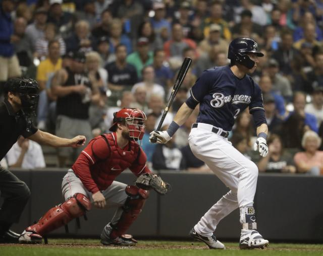 Milwaukee Brewers' Christian Yelich hits a single during the third inning of a baseball game against the Cincinnati Reds Wednesday, Sept. 19, 2018, in Milwaukee. (AP Photo/Morry Gash)