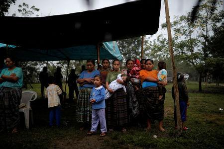 Friends and family members attend a service for Jakelin Caal, a 7-year-old girl who handed herself in to U.S. border agents earlier this month and died after developing a high fever while in the custody of U.S. Customs and Border Protection, at her home village of San Antonio Secortez, in Guatemala December 24, 2018. Picture taken December 24, 2018. REUTERS/Carlos Barria