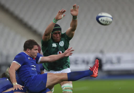 Ireland's Ultan Dillane attempts to charge down a kick by France's Antoine Dupont during the Six Nations rugby union international match between France and Ireland in Paris, France, Saturday, Oct. 31, 2020. (AP Photo/Thibault Camus)