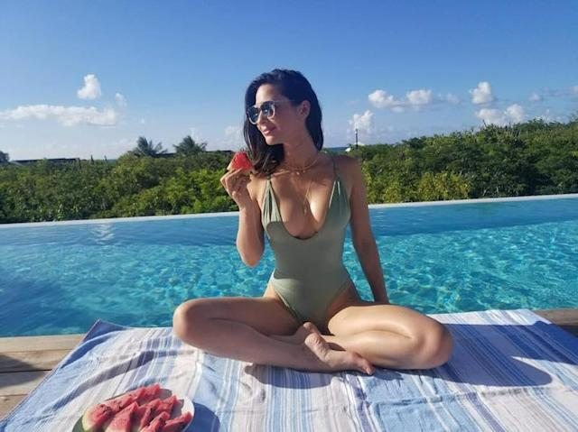 "<p>Life's just one big refreshingly juicy bite for the hot actress as she munches on a watermelon and lounges by the water. (Photo: <a href=""https://www.instagram.com/p/BV-VgQ8gwTv/?taken-by=oliviamunn"" rel=""nofollow noopener"" target=""_blank"" data-ylk=""slk:Olivia Munn via Instagram"" class=""link rapid-noclick-resp"">Olivia Munn via Instagram</a>) </p>"