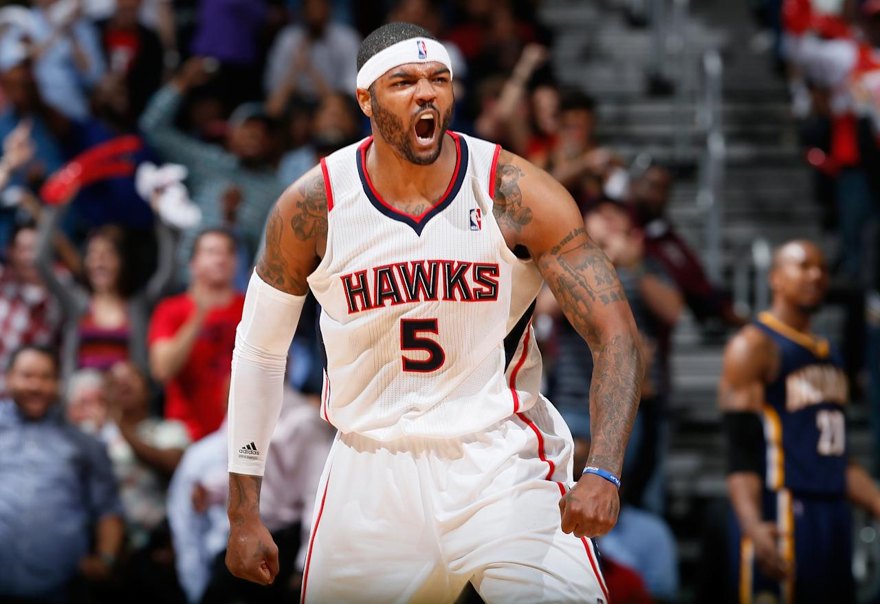 ATLANTA, GA - APRIL 29:  Josh Smith #5 of the Atlanta Hawks reacts after a basket in the final minutes of their 102-91 win over the Indiana Pacers during Game Four of the Eastern Conference Quarterfinals of the 2013 NBA Playoffs at Philips Arena on April 29, 2013 in Atlanta, Georgia.  NOTE TO USER: User expressly acknowledges and agrees that, by downloading and or using this photograph, User is consenting to the terms and conditions of the Getty Images License Agreement.  (Photo by Kevin C. Cox/Getty Images)