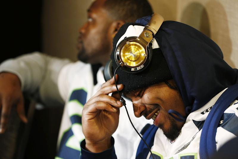 Marshawn Lynch #24 of the Seattle Seahawks sits in front of the media during an availability January 29, 2014 in Jersey City, New Jersey