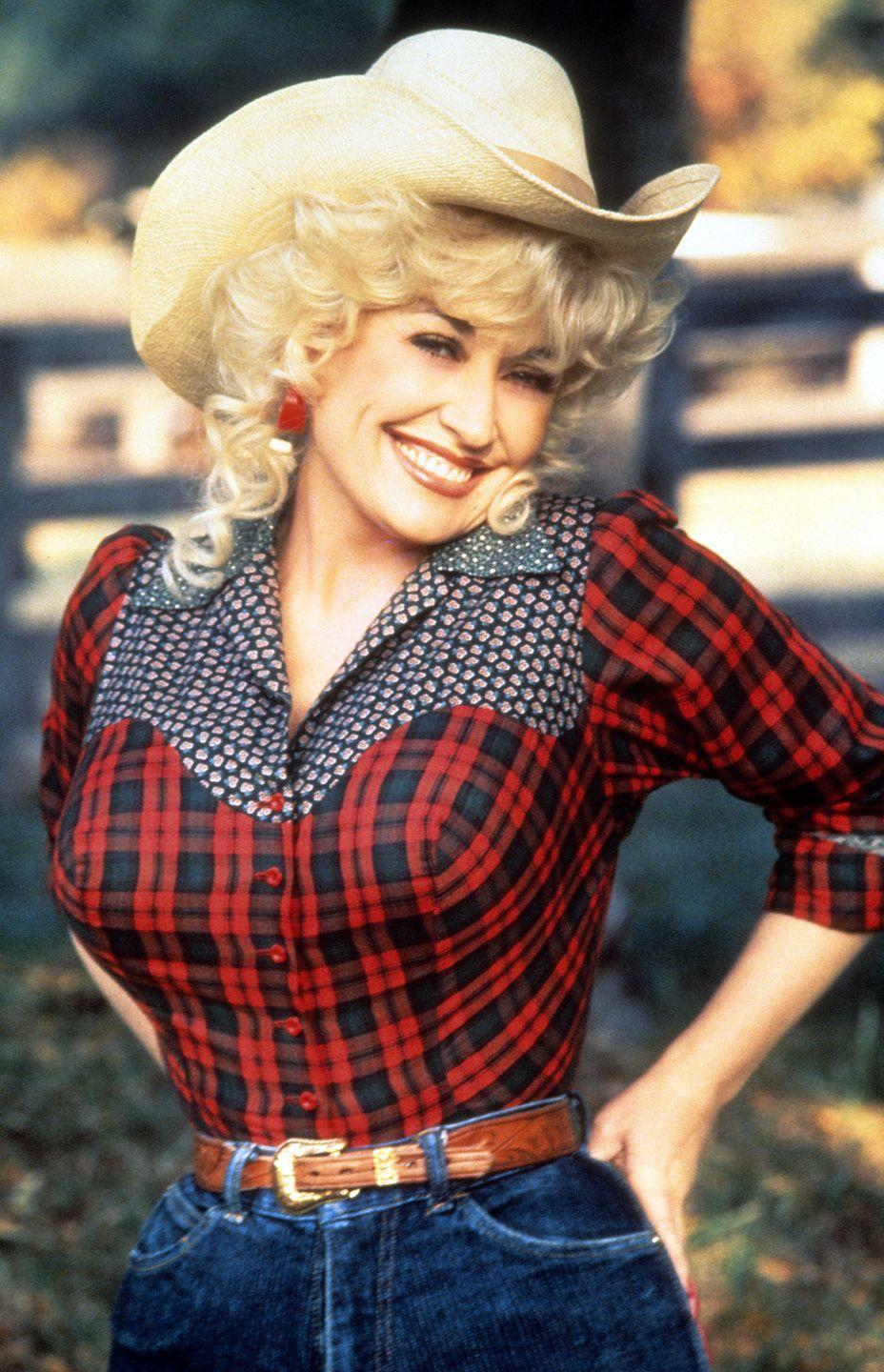 <p>In a promotional photo for the movie <em>Rhinestone</em>, Parton embraces cowgirl chic.</p>
