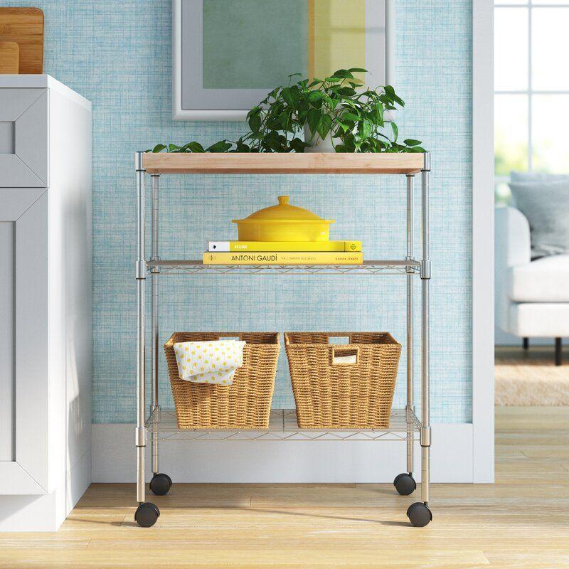 """<p><strong>Wayfair Basics</strong></p><p>wayfair.com</p><p><a href=""""https://go.redirectingat.com?id=74968X1596630&url=https%3A%2F%2Fwww.wayfair.com%2Ffurniture%2Fpdp%2Fwayfair-basics-adjustable-kitchen-cart-manufactured-wood-top-w004778584.html&sref=https%3A%2F%2Fwww.delish.com%2Fkitchen-tools%2Fcookware-reviews%2Fg36277927%2Fway-day-kitchen-deals-2021%2F"""" rel=""""nofollow noopener"""" target=""""_blank"""" data-ylk=""""slk:Shop Now"""" class=""""link rapid-noclick-resp"""">Shop Now</a></p><p><strong><del>$83</del> $67 (19% off)</strong></p><p>If you're pressed for storage space in your kitchen, this kitchen cart offers an aesthetically pleasing solution. You can also use the manufactured wood top as a slicing and dicing space while cooking too. </p>"""
