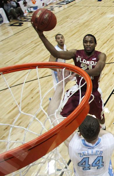 Florida State guard Michael Snaer (21) shoots as North Carolina forward Tyler Zeller (44) defends during the first half of an NCAA college basketball game in the final of the Atlantic Coast Conference men's tournament, Sunday, March 11, 2012, in Atlanta. (AP Photo/Chuck Burton)