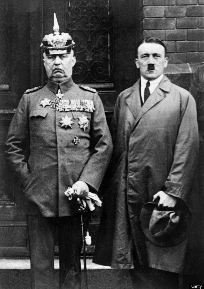 BERLIN, GERMANY: Paul von Hindenburg, 85, (L), German general and President (1847-1934) poses with the flamboyant Nazi leader Adolf Hitler (1889-1945) 30 January 1933 in Berlin after Hindenburg appointed Hitler as Chancellor of Germany. Hitler then suspended the constitution, silenced opposition, exploited successfully the burning of the Reichstag (Parliament) building, and brought the Nazi Party to power. (Photo credit should read AFP/Getty Images)