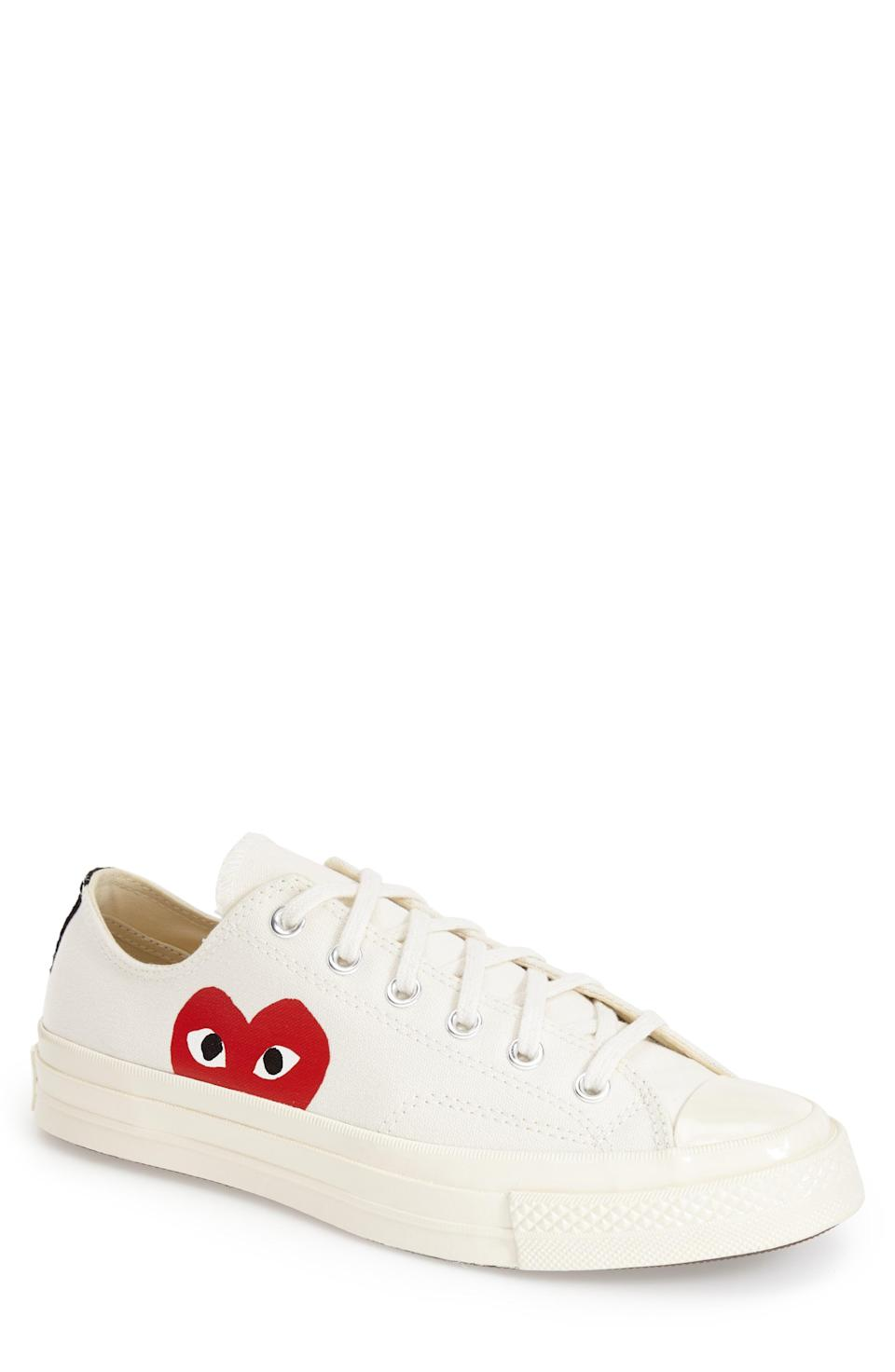 """<p><strong>COMME DES GARCONS PLAY</strong></p><p>nordstrom.com</p><p><strong>$150.00</strong></p><p><a href=""""https://go.redirectingat.com?id=74968X1596630&url=https%3A%2F%2Fwww.nordstrom.com%2Fs%2Fcomme-des-garcons-play-x-converse-chuck-taylor-hidden-heart-low-top-sneaker-unisex%2F4650436&sref=https%3A%2F%2Fwww.womenshealthmag.com%2Ffitness%2Fg36063460%2Fbest-black-sneakers%2F"""" rel=""""nofollow noopener"""" target=""""_blank"""" data-ylk=""""slk:Shop Now"""" class=""""link rapid-noclick-resp"""">Shop Now</a></p><p>From fashion giant Commes des Garçons, this unisex sneaker collab with Converse has to be one of the trendiest on this list. Beware—they're unisex, so your partner might """"borrow"""" them from you too often.</p>"""