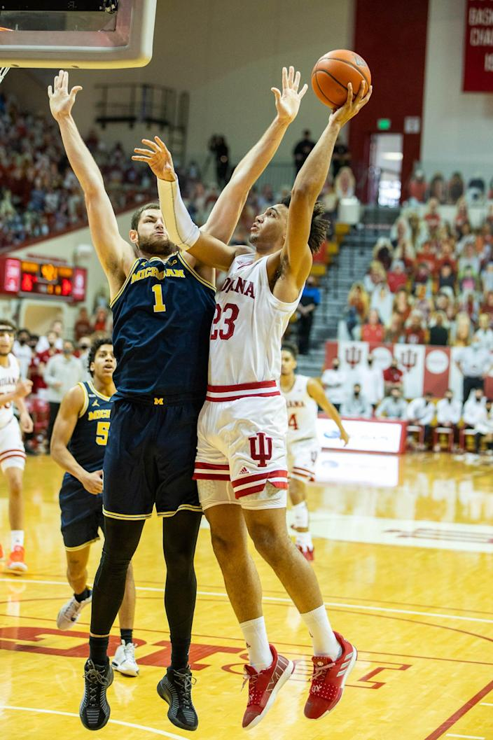 Indiana's Trayce Jackson-Davis shoots against Michigan's Hunter Dickinson in the first half Feb. 27, 2021 in Bloomington, Ind.