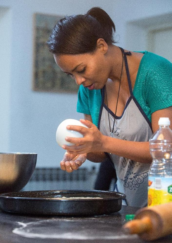 """The """"Okus Doma"""" cooking project was set up to welcome newcomers to Croatia who end up staying longer, whether they are fleeing war or persecution, coming for work or study, or moving for family reasons (AFP Photo/Damir Sencar)"""