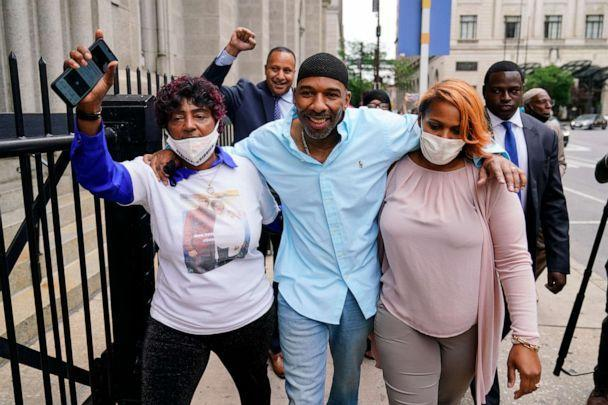 PHOTO: Eric Riddick, center, accompanied by his mother Christine Riddick, left, and wife Dana Baker-Riddick walks from a courthouse in Philadelphia on May 28, 2021, after spending nearly three decades in prison for a murder he says he did not commit. (Matt Rourke/AP)