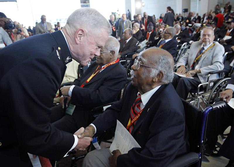 Commandant of the Marine Corps Gen. James F. Amos, left, greets James Huger, 97, of Dayton Beach, Fla., right, and other surviving members of the Montford Point Marines, during a Congressional Gold Medal ceremony at the U.S. Capitol in Washington, Wednesday, June 27, 2012. (AP Photo/Pablo Martinez Monsivais)
