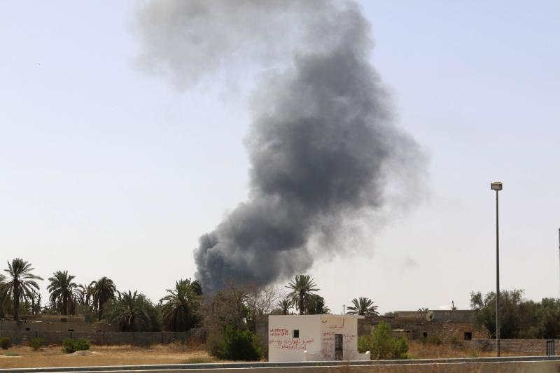 Smoke rises over the Airport Road area after heavy fighting between rival militias broke out near the airport in Tripoli