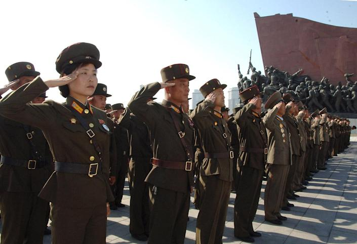 <p>Service personnel visit the statues of former North Korean leaders Kim Il Sung and Kim Jong Il in Pyongyang, April 25, 2015. (KCNA/Reuters) </p>