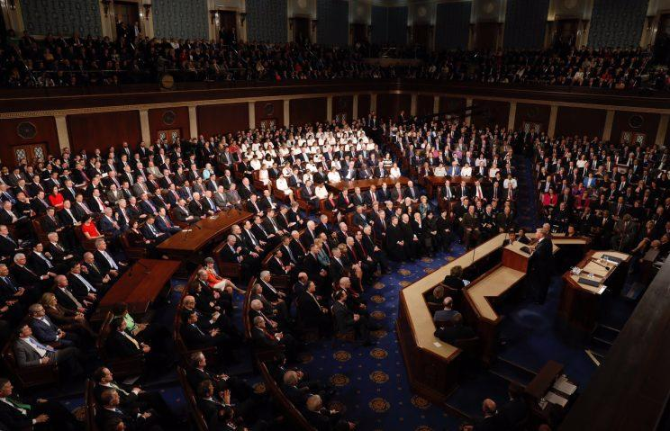 The democratic women of the House sat together and formed an entire section of white. (Photo: Reuters)