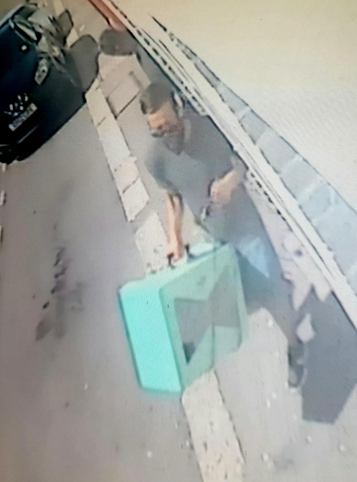 **EMBARGOED UNTIL 2PM BST / JULY 1, 2021**  CCTV of burglar in the pub and removing guitar and other goods to his car outside.  A brazen thief caught on camera stealing £5,000 worth of gear in Dover couldn't be nicked because he had left England by going through customs and was waiting for a ferry to France.  See SWNS story SWNNburglar.  The Italian committed the 'perfect crime' by raiding a pub and driving into a Channel ferry port - a few hundred yards away.  Once there, he couldn't be arrested - by Dover cops or the gendarme - despite being pointed out by the enraged victim.  He was deemed to be on French soil - while the burglary had been committed on British soil.  The bearded suspect, a 31 year old called Luca is understood to have arrived safely home in Italy.  Publican Jemima Burne, 29, was tipped off about the daylight raid by builders working at the Castle Inn.  He timed it to coincide with his hasty departure. He calmly strolled into the bar helping himself to a rare guitar, an amp and a variety of other goods.  He was caught on CCTV around 1pm on June 9 loading his swag into a dark blue Peugeot - and made off. But furious Jemima tracked him down - into the nearby terminal.