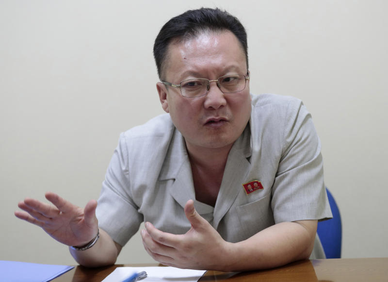 In this Sept. 12, 2019, photo, Kim Chang Kyong, Juche expert who is also the head of North Korean Social Scientists Association, speaks during an interview with The Associated Press in Pyongyang, North Korea. It's just a single word, but it's hard to miss in North Korea: Splashed across countless propaganda signs, seeded through dozens of state media reports, at the beating heart of emotional pop songs and on the lips of the earnest guides who show off the grand monuments built in its honor. The word is Juche, and while it's technically a political ideology, in its difficulty for many outsiders to grasp, its ability to inspire devotion among North Koreans, and its ubiquity as a symbol of state power, it can seem more like a religion. (AP Photo/Dita Alangkara)