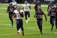 Tennessee Titans running back Derrick Henry (22) runs for a touchdown as Houston Texans defends chase him during the first half of an NFL football game Sunday, Jan. 3, 2021, in Houston. (AP Photo/Eric Christian Smith)