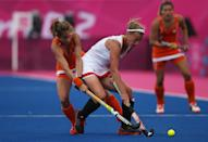 LONDON, ENGLAND - JULY 29: Gaelle Valcke of Belgium competes with Ellen Hoog of Netherlands during the Women's Pool WA Match W02 between the Netherlands and Belgium at the Hockey Centre on July 29, 2012 in London, England. (Photo by Daniel Berehulak/Getty Images)