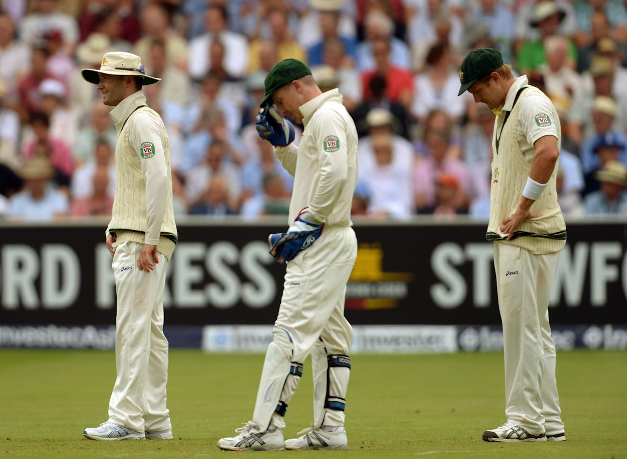 Australia's captain Michael Clarke (left), wicketkeeper Brad Haddin and Shane Watson (right) look dejected early on day three of the Second Investec Ashes Test at Lord's Cricket Ground, London.