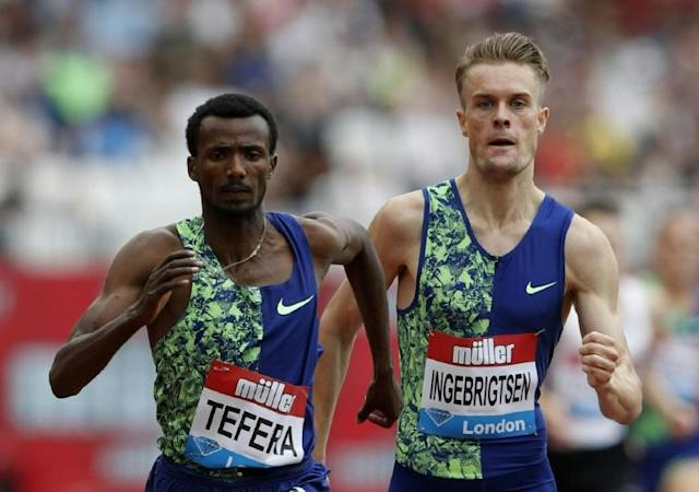 Ethiopia's Samuel Tefera (left) crosses the line ahead of Norway's Filip Ingebrigtsen to win the men's mile at the Anniversary Games in London (AFP Photo/)