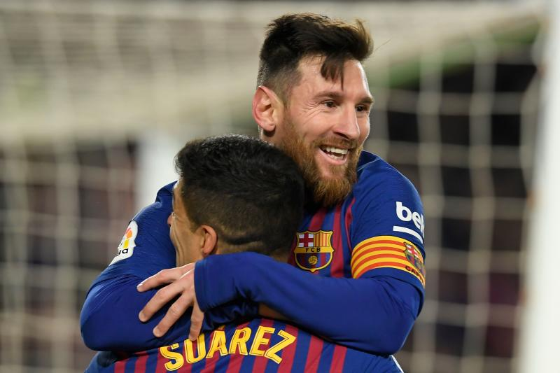 Barcelona's Argentinian forward Lionel Messi celebrates with Barcelona's Uruguayan forward Luis Suarez after scoring during the Spanish Copa del Rey (King's Cup) quarter-final second leg football match between Barcelona and Sevilla at the Camp Nou stadium in Barcelona on January 30, 2019. (Photo by LLUIS GENE / AFP) (Photo credit should read LLUIS GENE/AFP via Getty Images)