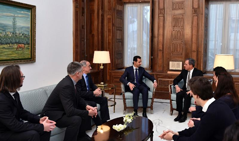 Syrian President Bashar al-Assad (C-L) meeting with French MP Thierry Mariani (C-R) and a delegation of French MP's in the Syrian capital Damascus on January 8, 2017