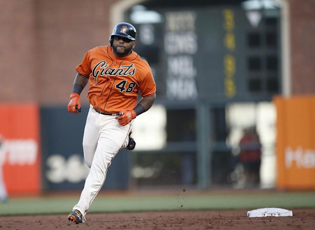 San Francisco Giants' Pablo Sandoval (48) rounds the bases after hits a three-un home run off Minnesota Twins starting pitcher Kyle Gibson in the first inning of a baseball game Friday, May 23, 2014, in San Francisco. (AP Photo/Tony Avelar)
