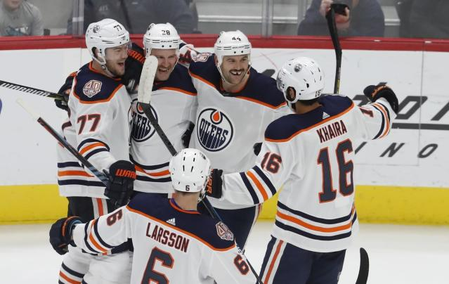 Edmonton Oilers center Kyle Brodziak (28) celebrates after a goal with teammates defenseman Oscar Klefbom (77), right wing Zack Kassian (44), left wing Jujhar Khaira (16) and defenseman Adam Larsson (6) during the third period of an NHL hockey game against the Detroit Red Wings, Saturday, Nov. 3, 2018, in Detroit. Edmonton won, 4-3. (AP Photo/Carlos Osorio)