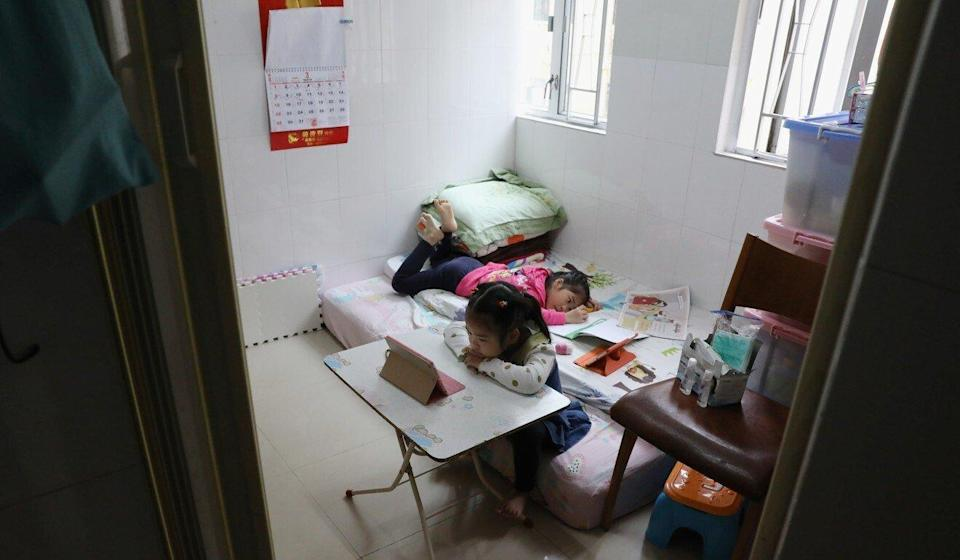 Two children do their homework in a subdivided flat in Tsuen Wan. Photo: K. Y. Cheng