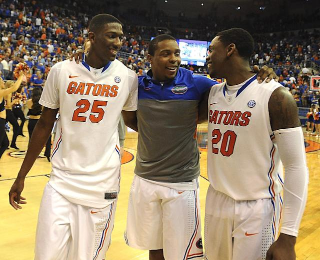 Florida's Lex Edwards, center, celebrates with forward DeVon Walker (25) and guard Michael Frazier II (20) after they defeated LSU 79-61 in an NCAA college basketball game on Saturday, March 1, 2014, in Gainesville, Fla. (AP Photo/Phil Sandlin)