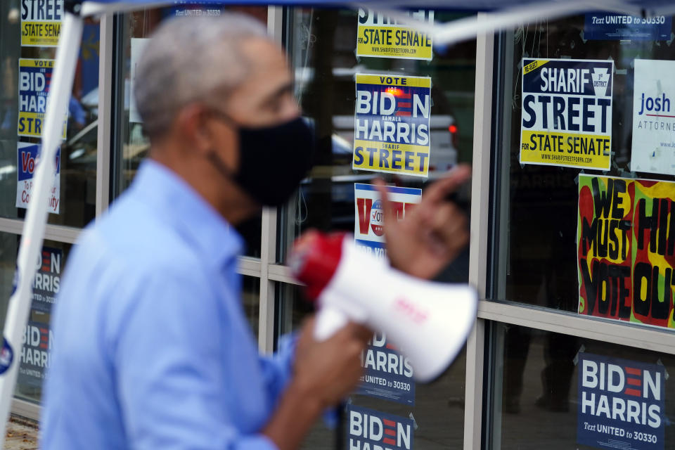 Former President Barack Obama speaks speaks to volunteers outside of a Democratic Voter Activation Center as he campaigns for Democratic presidential candidate former Vice President Joe Biden, Wednesday, Oct. 21, 2020, in Philadelphia. (AP Photo/ Matt Slocum)