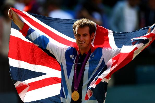 Gold medalist Andy Murray of Great Britain poses during the medal ceremony for the Men's Singles Tennis match on Day 9 of the London 2012 Olympic Games at the All England Lawn Tennis and Croquet Club on August 5, 2012 in London, England. Murray defeated Federer in the gold medal match in straight sets 2-6, 1-6, 4-6. (Photo by Paul Gilham/Getty Images)