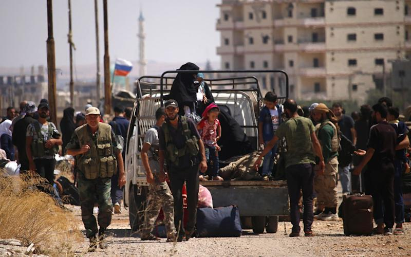 Syrian rebels and their relatives began evacuating Daraa marking a highly symbolic stage of the civil war - AFP