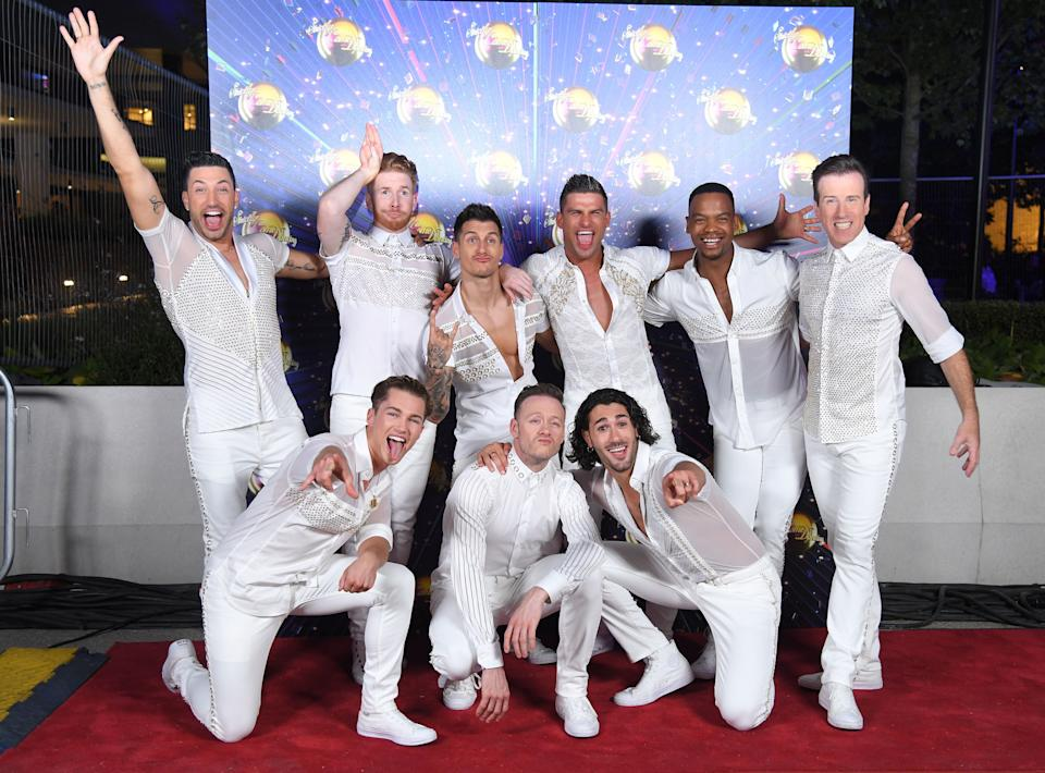 """LONDON, ENGLAND - AUGUST 26: (L-R back row) Giovanni Pernice, Neil Jones, Gorka Marquez, Aljaz Skorjanec, Johannes Radebe and Anton Du Beke (L-R front row) AJ Pritchard, Kevin Clifton and Graziano Di Prima attend the """"Strictly Come Dancing"""" launch show red carpet arrivals at Television Centre on August 26, 2019 in London, England. (Photo by Karwai Tang/WireImage)"""