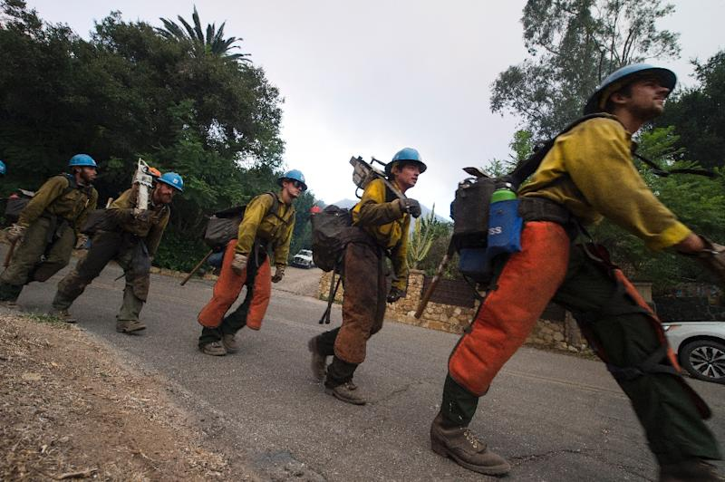 Fire crews in Montecito are on alert to tackle any hotspots that ignite from embers fanned by the winds (AFP Photo/Robyn Beck)