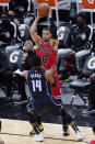 Chicago Bulls guard Zach LaVine (8) looks to pass the ball as Orlando Magic guard Gary Harris (14) defends during the first half of an NBA basketball game in Chicago, Wednesday, April 14, 2021. (AP Photo/Nam Y. Huh)