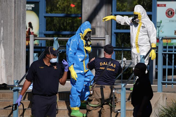 First responders wear full biohazard suits while responding to the report of a woman with Ebola-like symptoms at the Dallas Area Rapid Transit White Rock Station October 18, 2014 in Dallas, Texas (AFP Photo/Chip Somodevilla)