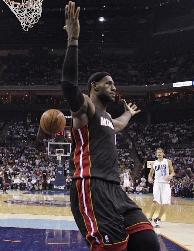 Miami Heat's LeBron James gestures after dunking against the Charlotte Bobcats during the first half in Game 4 of an opening-round NBA basketball playoff series in Charlotte, N.C., Monday, April 28, 2014. (AP Photo/Chuck Burton)