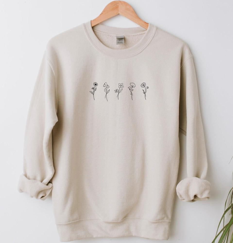 """<h2>Symbolic Imports Custom Birth Month Flower Sweatshirt<br></h2><br>No one rocks a sweatshirt like your mom — she brought the activewear staple to fashionable heights at the peak of her aerobics phase in the early '90s. This under-$30 topper is available in almost 50 different colors, and can be customized with birth flowers for different months of the year — the perfect, sentimental reminder of her kids or family members that you know she'll actually wear. <br><br><em>Shop <strong><a href=""""https://www.etsy.com/shop/SymbolicImports?ref=simple-shop-header-name&listing_id=980429190"""" rel=""""nofollow noopener"""" target=""""_blank"""" data-ylk=""""slk:Symbolic Imports"""" class=""""link rapid-noclick-resp"""">Symbolic Imports</a> </strong>on Etsy</em><br><br><strong>Symbolic Imports</strong> Custom Birth Month Flower Sweatshirt, $, available at <a href=""""https://go.skimresources.com/?id=30283X879131&url=https%3A%2F%2Fwww.etsy.com%2Flisting%2F980429190%2Fcustom-birth-month-birth-flower"""" rel=""""nofollow noopener"""" target=""""_blank"""" data-ylk=""""slk:Etsy"""" class=""""link rapid-noclick-resp"""">Etsy</a>"""