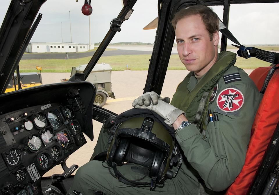 <p>The Duke of Cambridge at the controls of a Sea King helicopter before he trained as an air ambulance pilot. He worked full time for the East Anglian Air Ambulance. (MOD)</p>