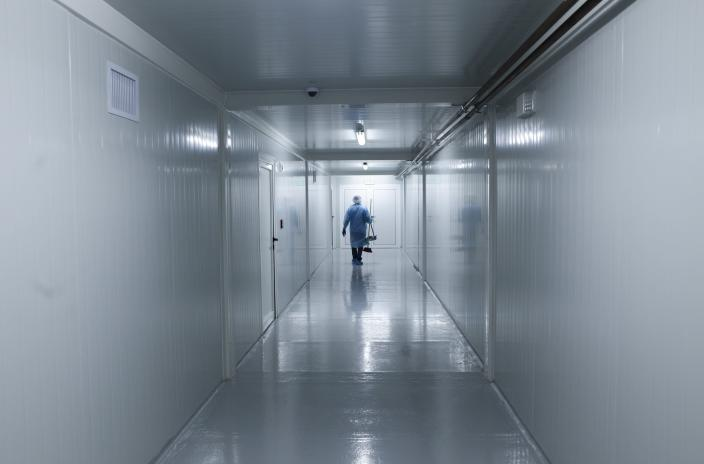 FILE - In this April 16, 2020, file photo, a worker wearing protective gear walks down the corridor of a new health facility that will take in patients infected with the new coronavirus, during a media presentation in Panama City. Even amid a global pandemic, there's no sign that corruption is slowing down in Latin America. From Argentina to Panama, a number of officials have been forced to resign as reports of possibly fraudulent purchases of ventilators, masks and medical supplies proliferate. (AP Photo/Arnulfo Franco, File)
