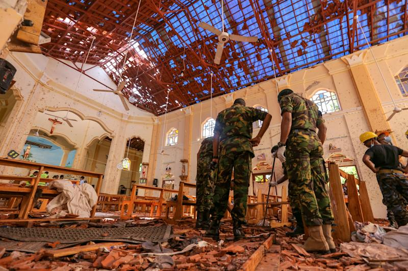 Sri Lankan soldiers inspect the damage inside St. Sebastian's Church where a bomb blast took place in Negombo. Source: Getty Images