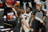 Arizona State's Kimani Lawrence, right, blocks a shot by Washington State's Aljaz Kunc during the second half of an NCAA college basketball game in the first round of the Pac-12 men's tournament Wednesday, March 10, 2021, in Las Vegas. (AP Photo/John Locher)